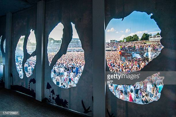 Festival goers are pictured through a fantasy corridor during the third day of the ninth edition of the Tomorrowland music festival on July 28 2013,...