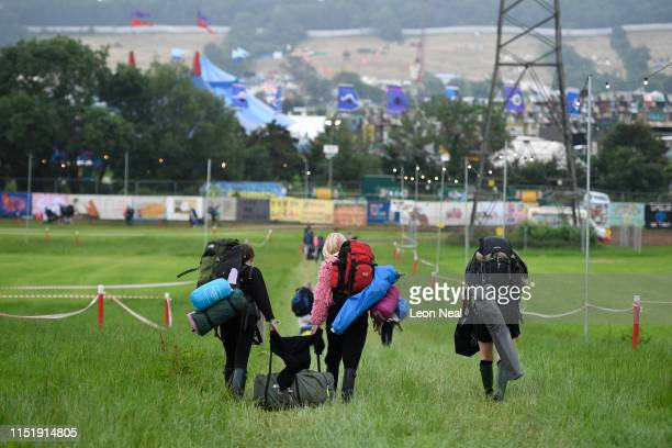 Festival goers arrive as the gates open during day one of Glastonbury Festival at Worthy Farm, Pilton on June 26, 2019 in Glastonbury, England. The...
