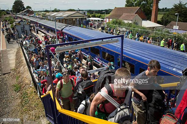 Festival goers arrive at Castle Cary station for the first day of the 2014 Glastonbury Festival on June 25 2014 in London England Gates opened today...