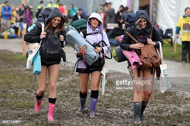 Festival goers arrive at the Glastonbury Festival 2016 at Worthy Farm Pilton on June 22 2016 in Glastonbury England