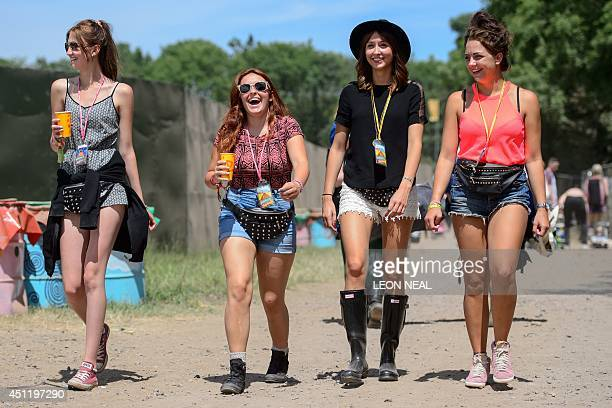 Festival goers arrive with their tents and drink supplies as the gates open at the Glastonbury Festival of Music and Performing Arts in Somerset...