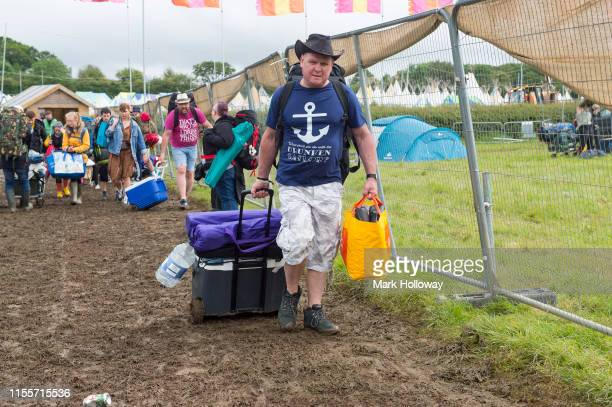 Festival goers arriving at Isle of Wight Festival 2019 at Seaclose Park on June 13 2019 in Newport Isle of Wight