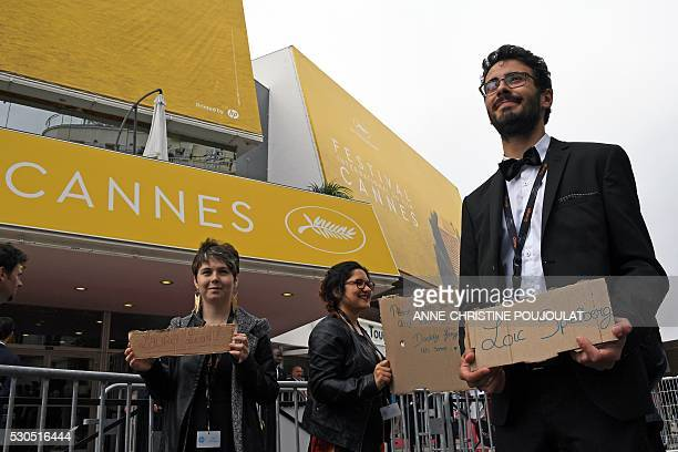 Festival goers ask for cinema tickets outside the Festival palace on May 11 2016 ahead of the opening of the 69th Cannes Film Festival southern...