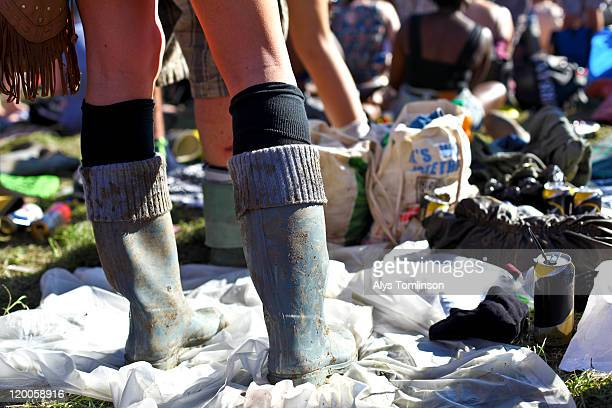 festival goers at glastonbury festival 2011 - wellington boot stock pictures, royalty-free photos & images