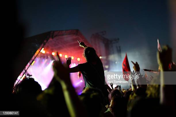 festival goers at the glastonbury festival 2011 - glastonbury stock pictures, royalty-free photos & images