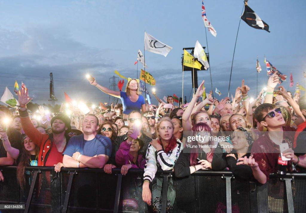 Festival goers attend day 4 of the Glastonbury Festival 2017 at Worthy Farm, Pilton on June 25, 2017 in Glastonbury, England.