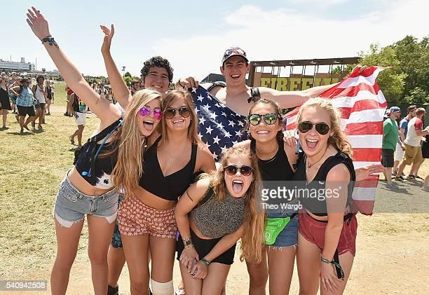 Festival goers attend Firefly Music Festival on June 17, 2016 in Dover, Delaware.