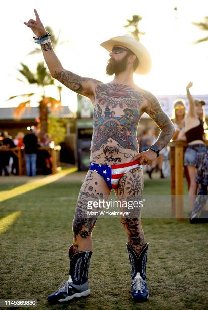 Festival goers attend the 2019 Stagecoach Festival at Empire Polo Field on April 26 2019 in Indio California