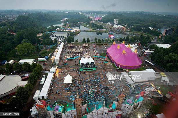 Festival goers attend the first day of the 8th edition of the Tomorrowland music festival in Boom on July 27 2012 This year's Tomorrowland is taking...