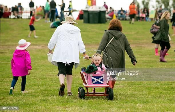 Festival goers attend the Wickerman Festival at Dundrennan on July 24 2015 in Dumfries Scotland