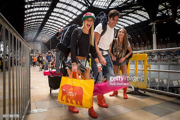 Festival goers board trains at Paddington station to travel to Castle Cary station for the first day of the 2014 Glastonbury Festival on June 25 2014...