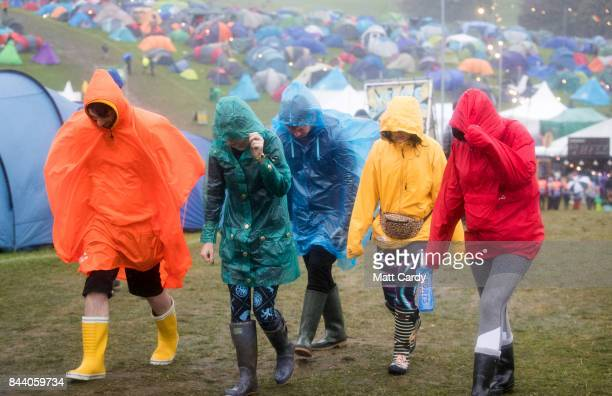 Festival goers brave the wind and the rain at Bestival festival being held at the Lulworth Estate on September 8 2017 in Dorset England Described as...