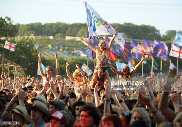 Festival goers celebrate the 40th anniversary of Glastonbury Festival whilst watching Faithless on The Pyramid stage on the final day of the festival...