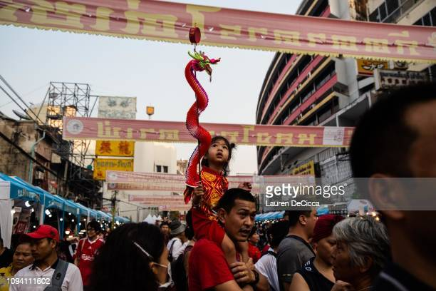 Festival goers celebrate the Chinese Lunar New Year on Yarowat Road in Chinatown on February 5 2019 in Bangkok Thailand