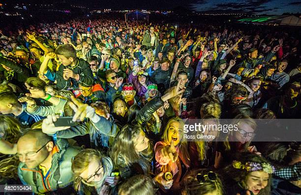 Festival goers cheer at the main stage at the Wickerman festival at Dundrennan on July 25 2015 in Dumfries Scotland