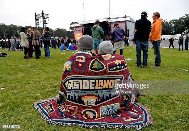 Festival goers cover up under a blanket during the 2016 Outside Lands Music And Arts Festival at Golden Gate Park on August 5 2016 in San Francisco...