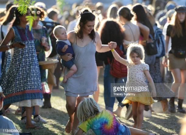 Festival goers dance in late afternoon sun during 2019 WOMADelaide on March 09, 2019 in Adelaide, Australia.