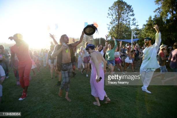 Festival goers dance in the Colour of Time performance by Cie Artonik during 2019 WOMADelaide on March 09, 2019 in Adelaide, Australia. The...
