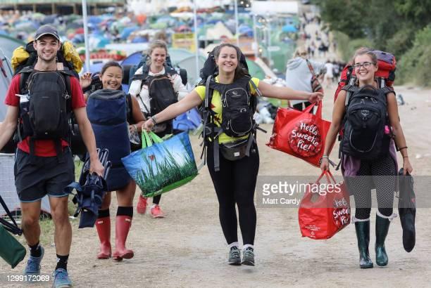 Festival goers depart from the 2019 Glastonbury Festival held at Worthy Farm, in Pilton, Somerset on July 1, 2019 near Glastonbury, England. The...