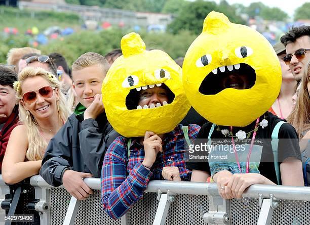 Festival goers dressed as Earl of Lemongrab of Adventure Time enjoy Glastonbury Festival 2016 at Worthy Farm Pilton on June 25 2016 in Glastonbury...