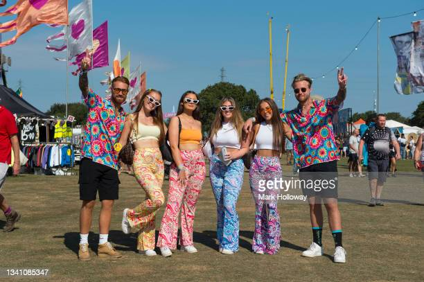 Festival goers dressed in this years theme of Peace, Love & Understanding at Isle Of Wight Festival 2021 at Seaclose Park on September 18, 2021 in...