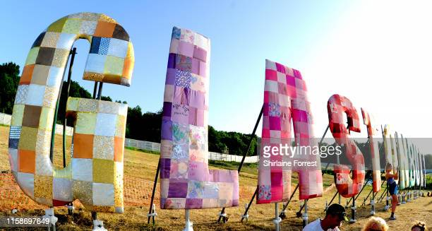 Festival goers enjoy day two of Glastonbury Festival at Worthy Farm Pilton on June 27 2019 in Glastonbury England