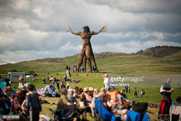 Festival goers enjoy the atmosphere as clouds loom overhead during the Wickerman festival at Dundrennan on July 25, 2015 in Dumfries, Scotland.