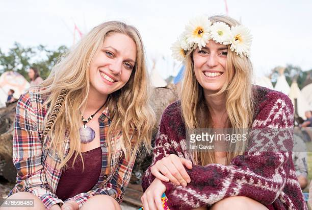 Festival goers enjoy the atmosphere at the Glastonbury Festival at Worthy Farm Pilton on June 25 2015 in Glastonbury England Now its 45th year the...