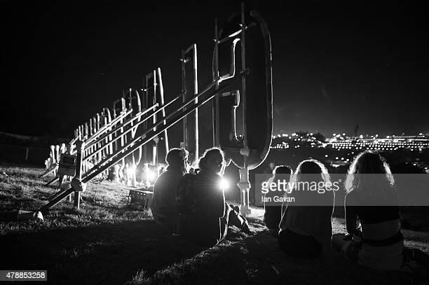 Festival goers enjoy the atmosphere at the Glastonbury Festival at Worthy Farm, Pilton on June 28, 2015 in Glastonbury, England. Now its 45th year...