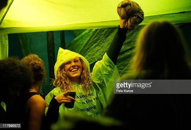 Festival goers enjoy the atmosphere despite heavy rainfall on day three of Roskilde Festival 2011 on July 2 2011 in Roskilde Denmark