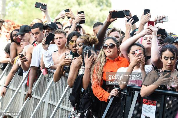 Festival goers enjoy the atmosphere in crowd of the Main Stage during Day 3 of Wireless Festival 2018 at Finsbury Park on July 8 2018 in London...