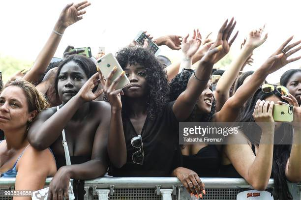 Festival goers enjoy the atmosphere in the crowd on Day 2 of Wireless Festival 2018 at Finsbury Park on July 7 2018 in London England