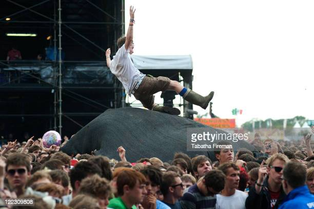 Festival goers enjoy the atmosphere of the crowd as they watch Madness perform on the Main Stage during day two of Reading Festival at Richfield...