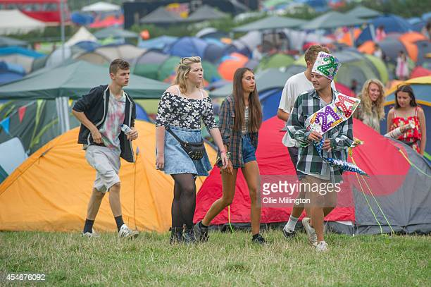 Festival goers enjoy the atmosphere on Day 2 of Bestival at Robin Hill Country Park on September 5 2014 in Newport Isle of Wight