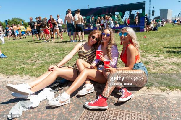 Festival goers enjoy the sun on the second day of the TRNSMT Festival at Glasgow Green on June 30 2018 in Glasgow Scotland