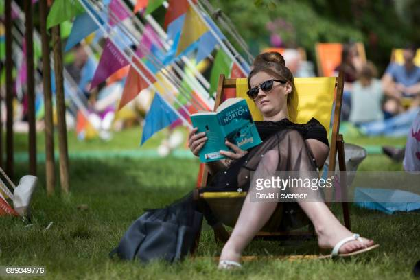 Festival goers enjoy the sunshine at the Hay Festival on May 28 2017 in Hay on Wye United Kingdom