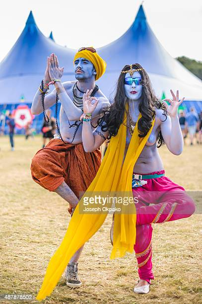 Festival goers enjoy the sunshine on day 3 of Bestival at Robin Hill Country Park where the theme s Summer of Love on September 12 2015 in Newport...