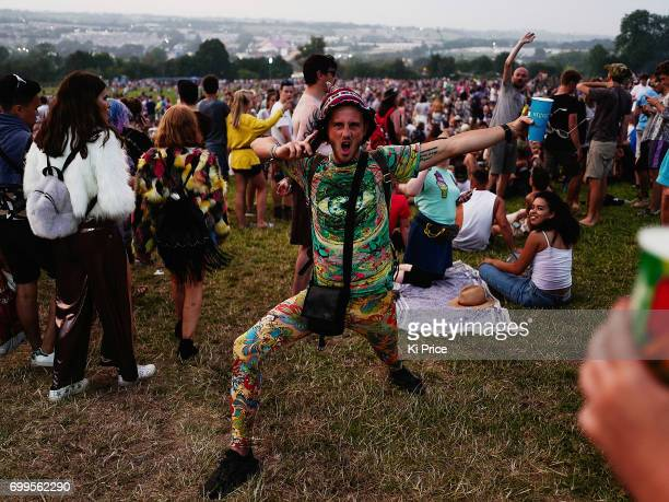 Festival goers enjoy themselves as the gates open at the Glastonbury Festival amid heightened security at Worthy Farm in Pilton on June 21 2017 near...