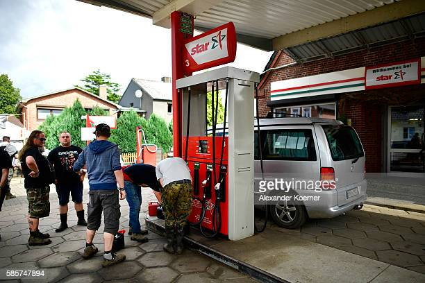 Festival goers fill up at a gas station during the Wacken Open Air festival on August 4 2016 in Wacken Germany Wacken is a village in northern...