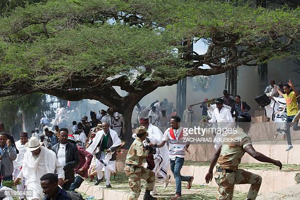 Festival goers flee during a deadly stampede in Bishoftu on October 2 2016 Several people were killed in a stampede near the Ethiopian capital on...