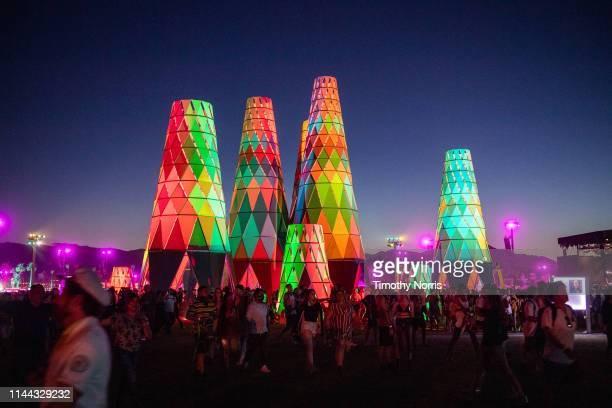 Festival goers gather and walk around Sarbale ke during the 2019 Coachella Valley Music And Arts Festival on April 21 2019 in Indio California