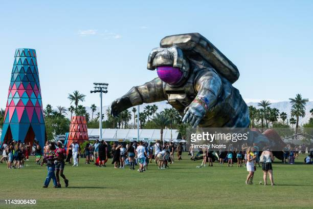 Festival goers gather around Overview Effect during 2019 Coachella Valley Music And Arts Festival on April 19 2019 in Indio California