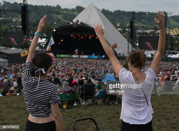 Festival goers gather in front of the main Pyramid Stage at Worthy Farm in Pilton during the 2014 Glastonbury Festival on June 29 2014 in Glastonbury...