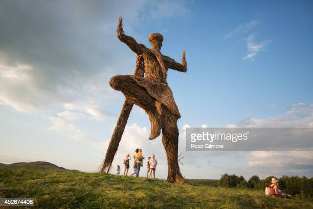 Festival goers gather under the Wickerman on day one at Dundrennan on July 25, 2014 in Dumfries, United Kingdom.