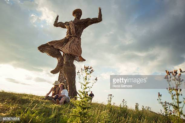 Festival goers gather under the Wickerman on day one at Dundrennan on July 25 2014 in Dumfries United Kingdom