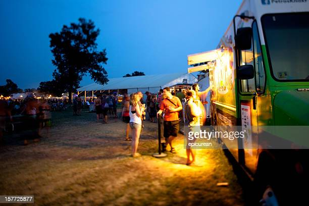Festival goers getting dinner from a food truck