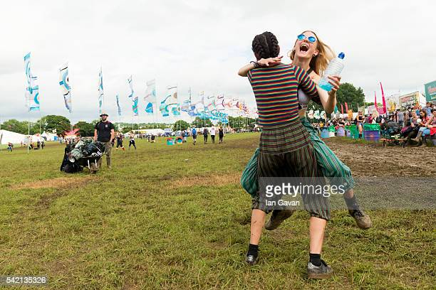 Festival goers greet each other at the Glastonbury Festival at Worthy Farm, Pilton on June 22, 2016 in Glastonbury, England. Now its 46th year the...