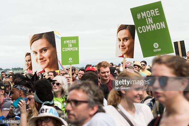 Festival goers hold placards to remember Jo Cox at an event on the Park stage during the Glastonbury Festival at Worthy Farm, Pilton on June 23, 2016...