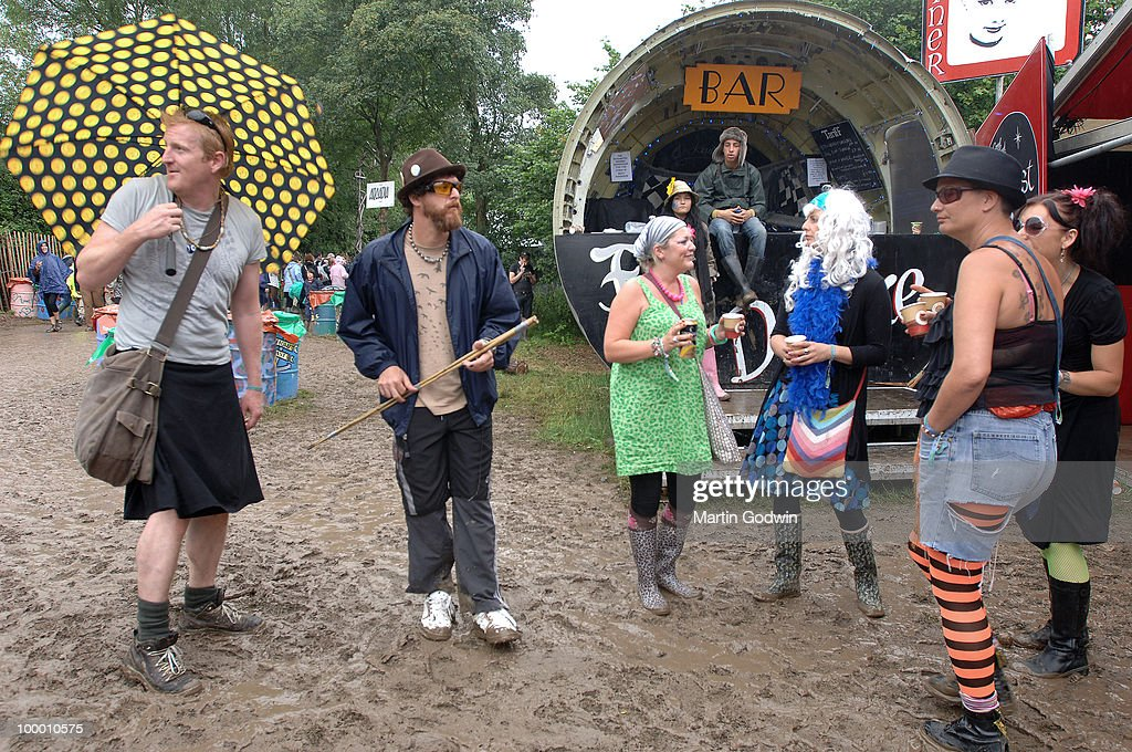 Festival Goers in fancy dress in front of the nose cone bar in Shangri-La at Glastonbury, 26th June 2009.