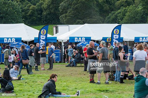 Festival goers in the bar area of a music festival